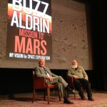 Buzz Aldrin in conversation with Leonard David. Photo Credit: Barbara David