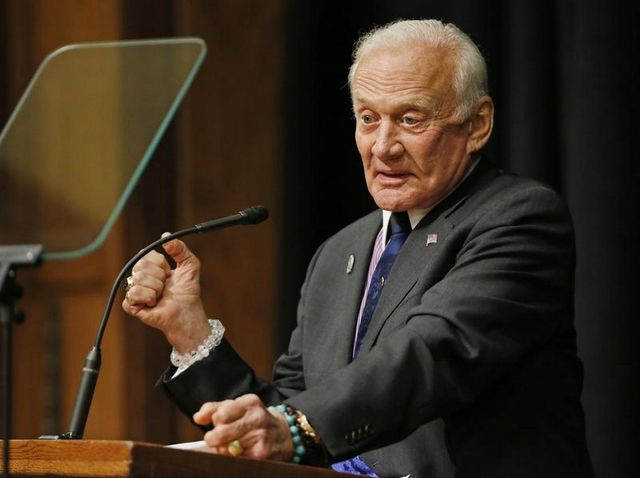 Buzz Aldrin, the astronaut who walked on the moon with Neil Armstrong, discusses his plan for the future of space exploration Wednesday in the South Ballroom of the Purdue Memorial Union. / John Terhune/Journal & Courier